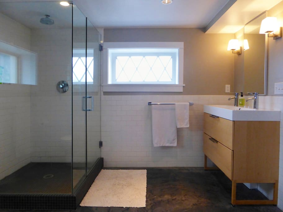 Very large bathroom with dual-faucet sink, rain-shower and radiant heat floors