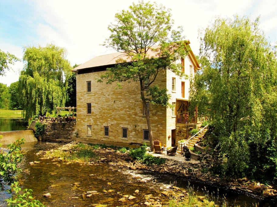 The Island Mill Getaway circa 1832 converted stone grist and flour mill nestled in the Salmon River in the hamlet of Lonsdale.  The Miller's Retreat suite is situated on the lower level with private entrance and patio.