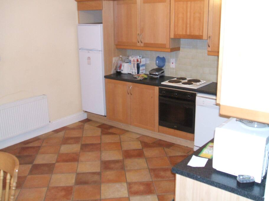 Kitchen with all mod cons Fridge, Washing Machine , DishWasher , Dryer, Cooker, Microwave