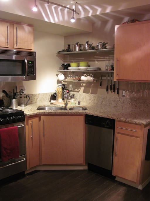 Fully stocked kitchen with electric stove, microwave, and dishwasher