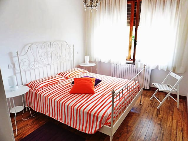 Double bedroom with large wardrobe & hand made, hardwood floors throughout