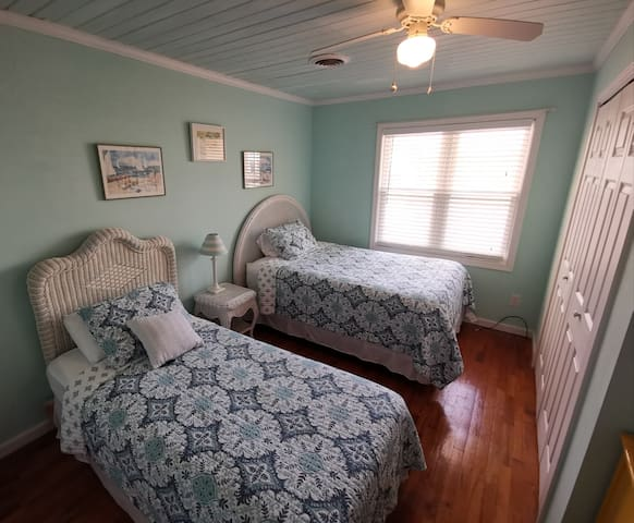 Marsh view bedroom with full size and twin size beds, laundry closet with full size washer and dryer