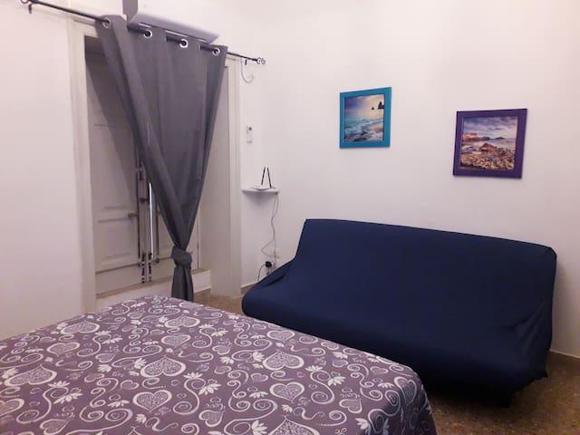 Camera da letto più divano letto