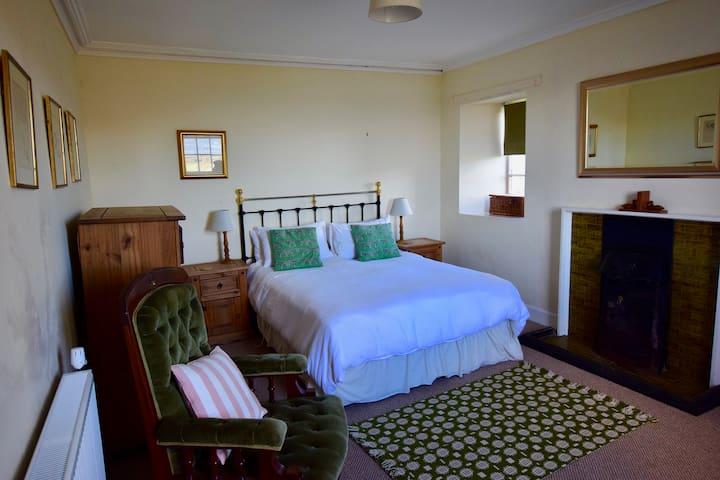 Downstairs double bedroom wiht sea views