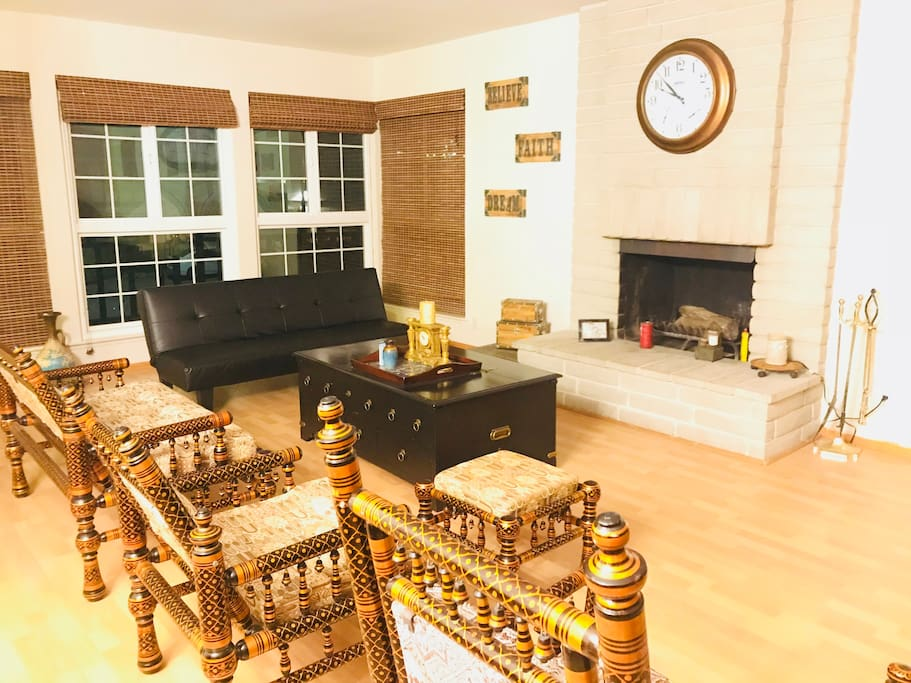 Handmade indian furniture , fireplace and black leather sleeping sofa.
