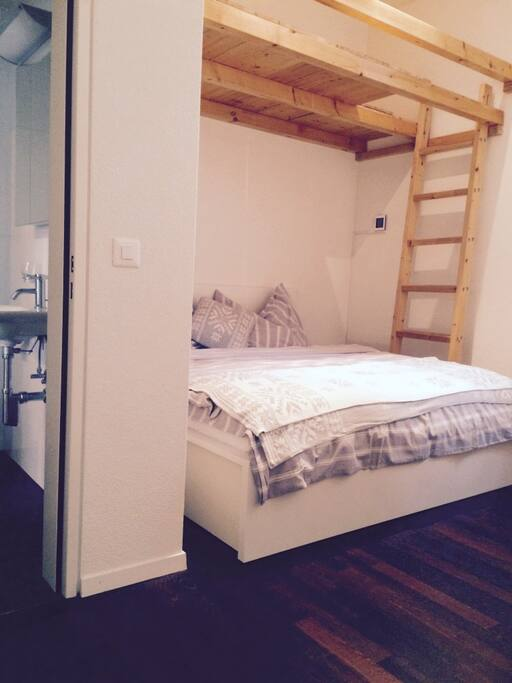 Double bed with ensuite WC and loft for storage.