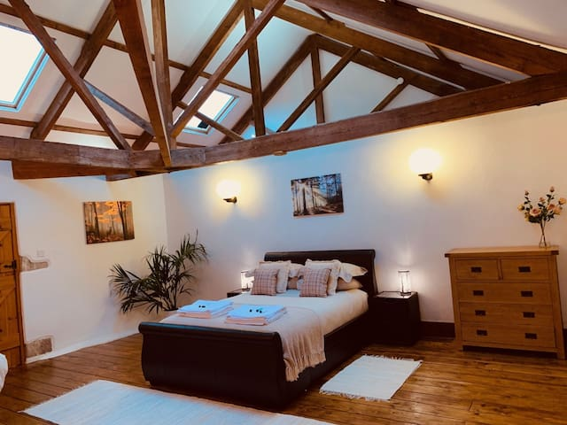 Beautiful King Suite with exposed Beams