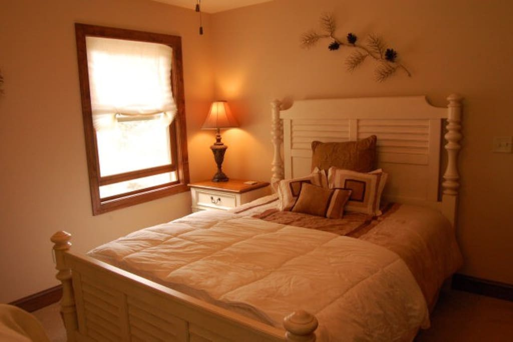 Queen bed with dresser...open the window to hear the creek