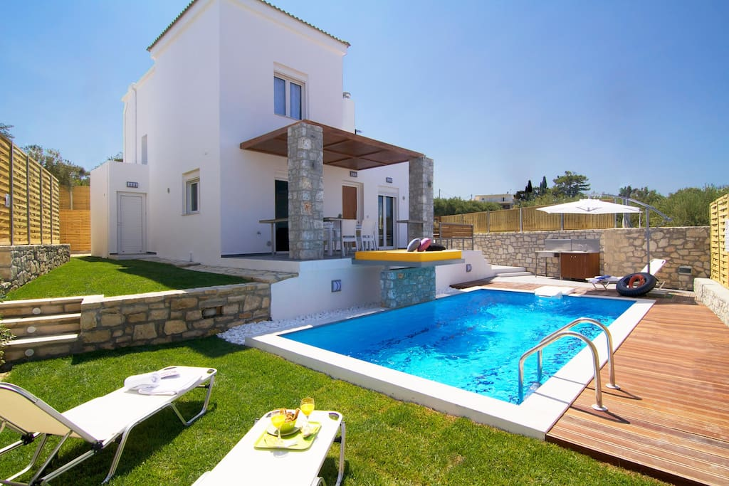 Pool view with wooden deck and outdoor barbaque
