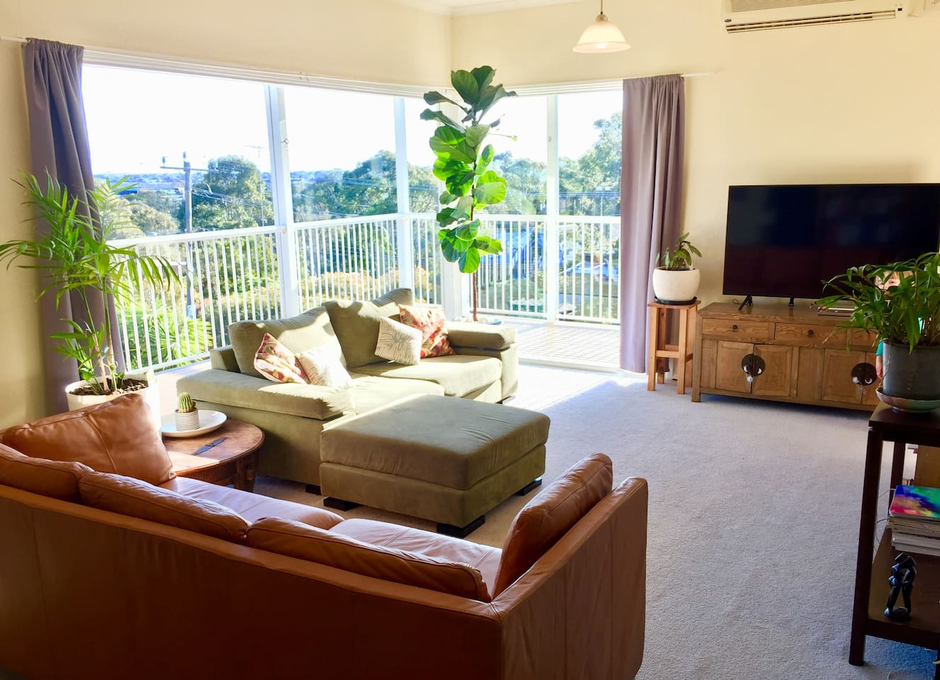 Lounge with views towards the Barwon river to setting sun