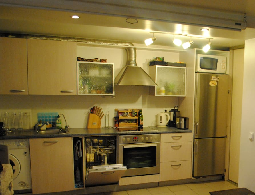 All you need in the kitchen, good oven, refrigerator, microwave oven, dishwashing machine,  cupboards full of all the stuff you might need. Also washing mashine to the left; wardrobe and shelves to store your stuff to the right.
