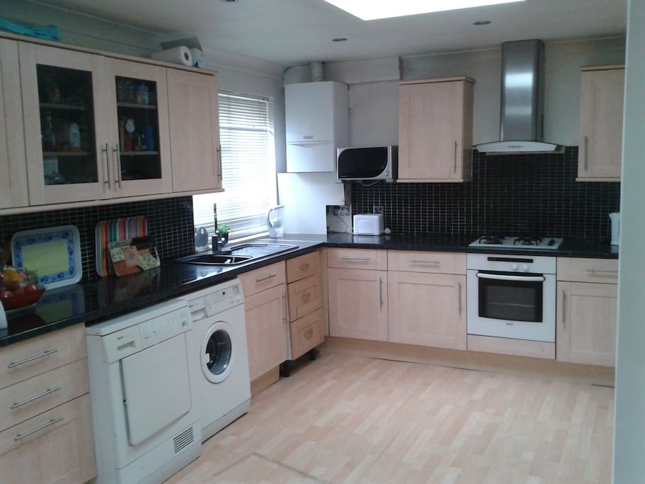Modern Kitchedn with Washing Machine and other eminities