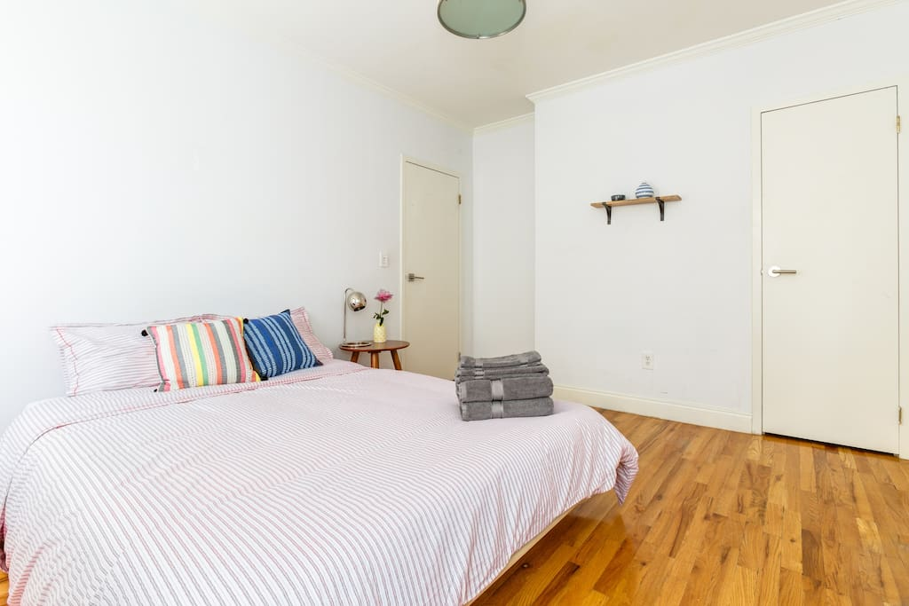 Private spacious bedroom featuring a queen size bed,  memory foam mattress and closet for storage.
