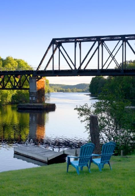 Enjoy the tranquil and scenic waterfront views, watersports dock and fire pit