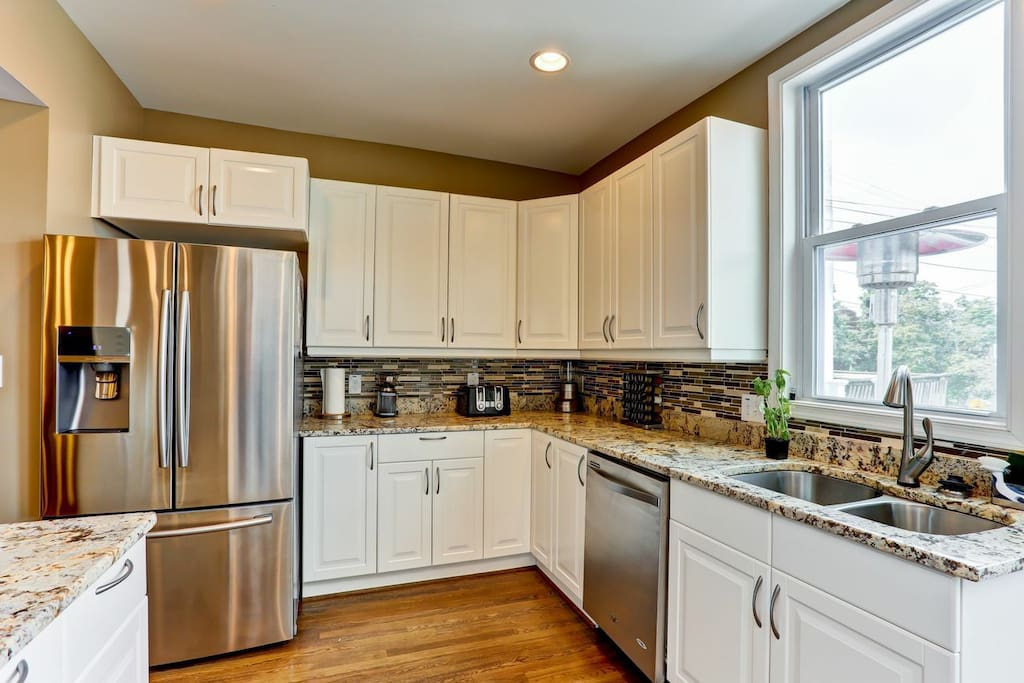 Ample cabinet spaces and dishwasher.