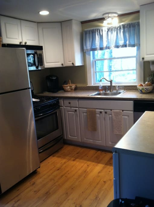 Updated kitchen with dishwasher, microwave, new fridge, coffee pot & kuerig.