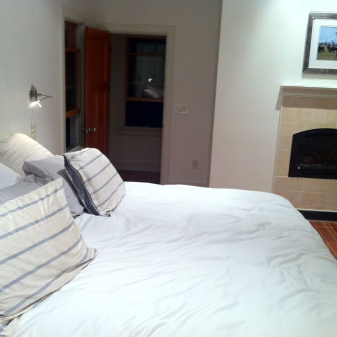 King bed in MBR with fireplace