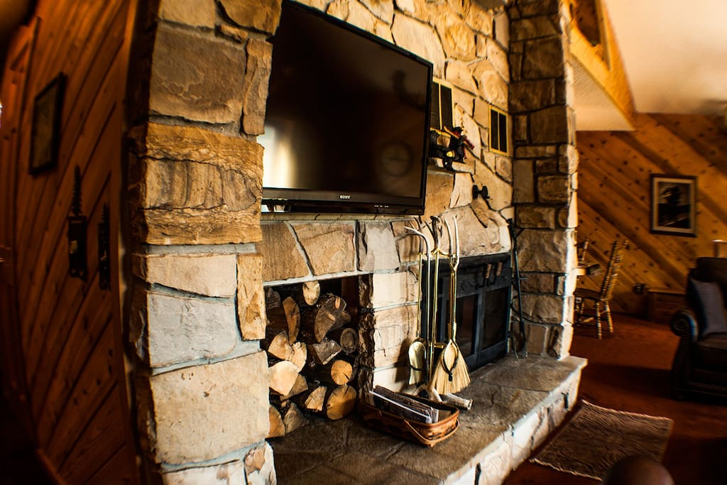 Stone Wood Burning Fireplace & Flatscreen TV