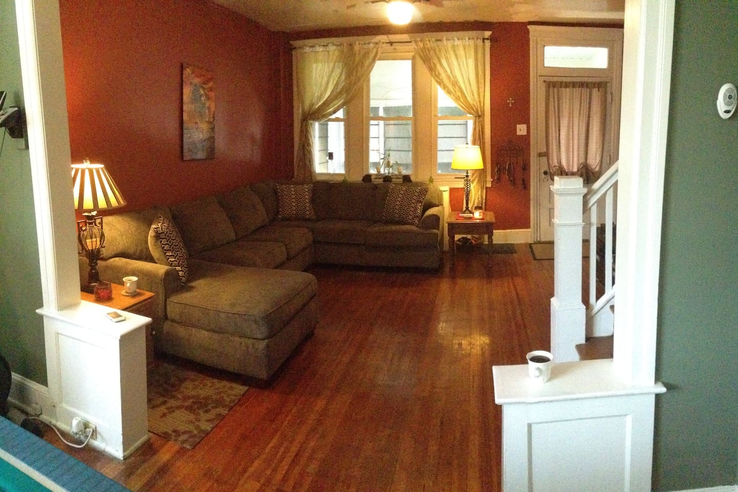 The spacious living room as you walk in after. An entertainment system awaits!