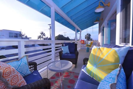 Endless Summer's Sunset Suite: enjoy the ocean views, fresh decor and 2 balconies