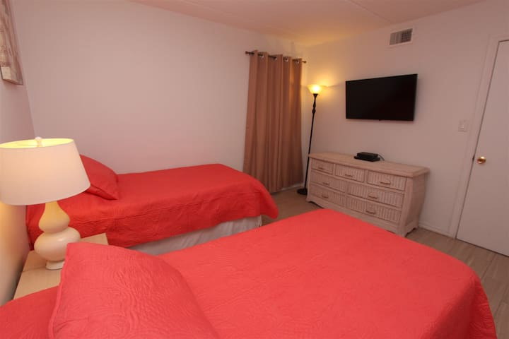 The Guest Bedroom Features Two Twin Beds