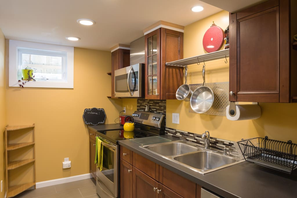 With this new kitchen, make a meal from the Farmer's Market.  Or just have some tea or Stumptown or other local Coffee (provided). Window cranks open into a private, quiet tall fence enclosed area (no driveways nearby).