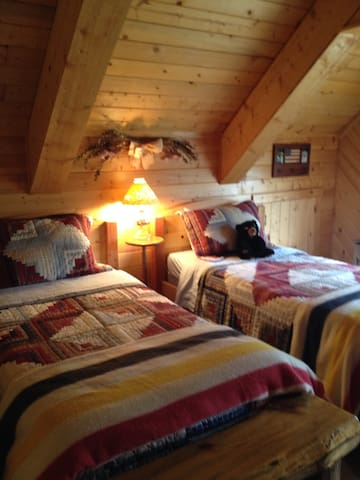 Two twin beds on top floor OPEN loft. Kids love it.