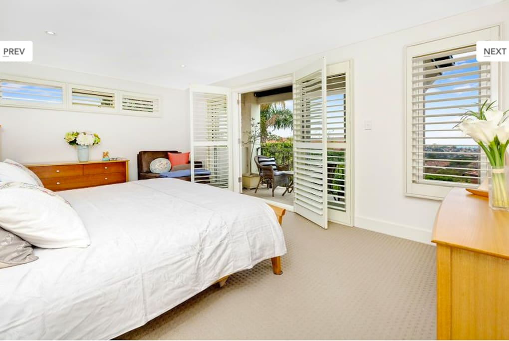 Master bedroom with balcony and views to Manly