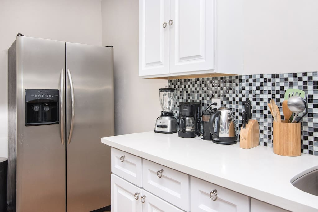 Kitchen is renovated with stainless steel fridge and granite countertops. Well stocked for you cooks.