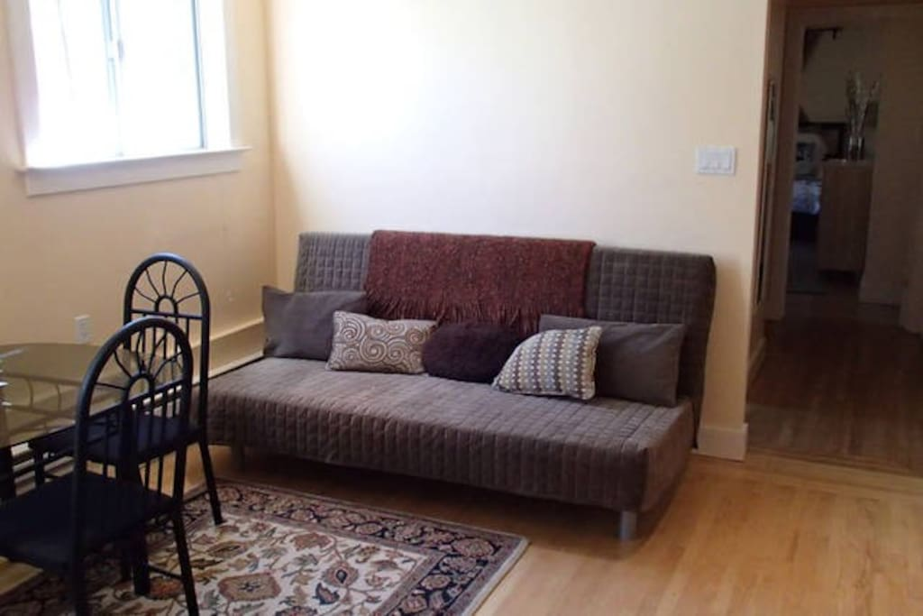 Living room with Sofa Bed, Eating area, and Kitchen