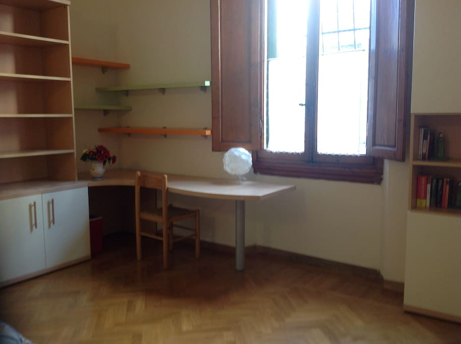 Desk and bookcase. The room overlooks the street which is very quiet.