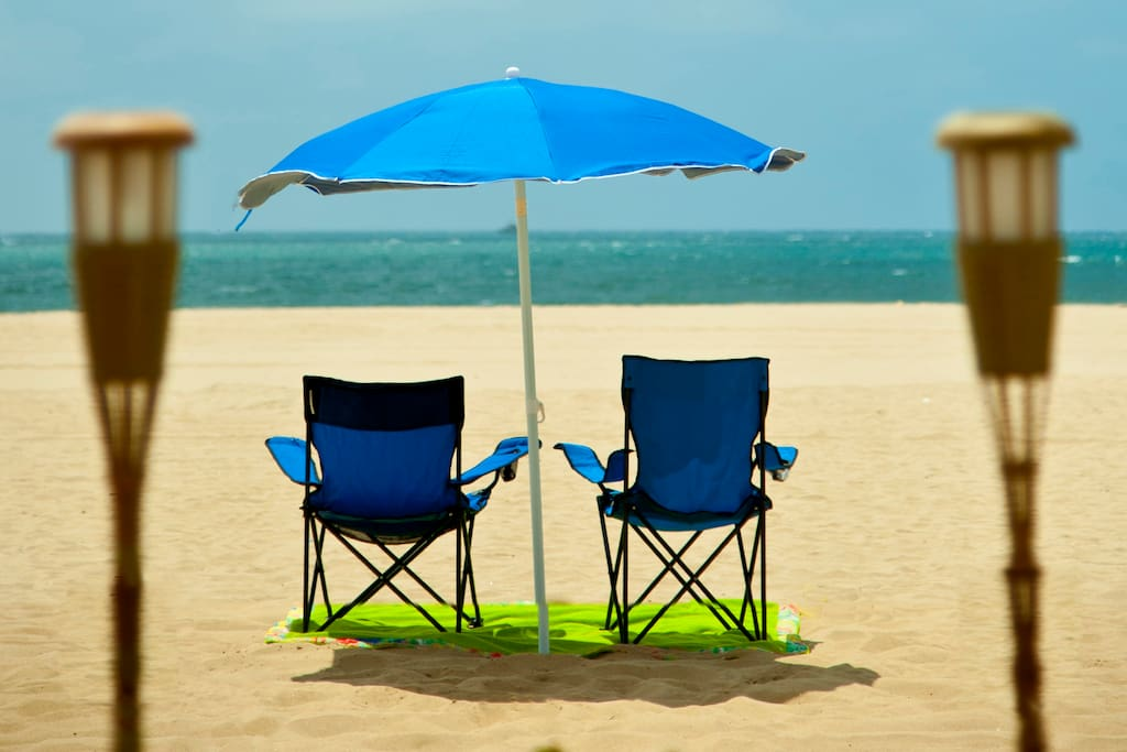 Portable beach chairs and umbrella. YES, this is the view from our private sand patio.