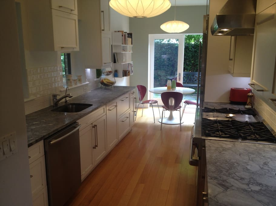 Kitchen features Wolf range and Subzero fridge, Miele dishwasher and lots of counter space.