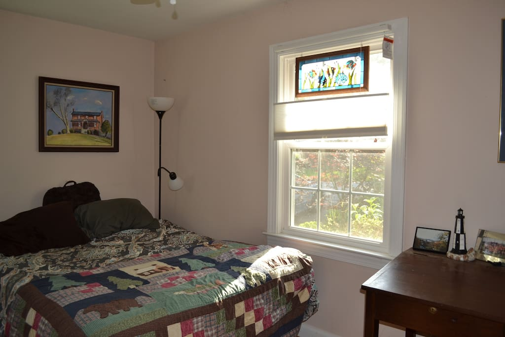 The front bedroom with Queen Bed, desk, and lots of light