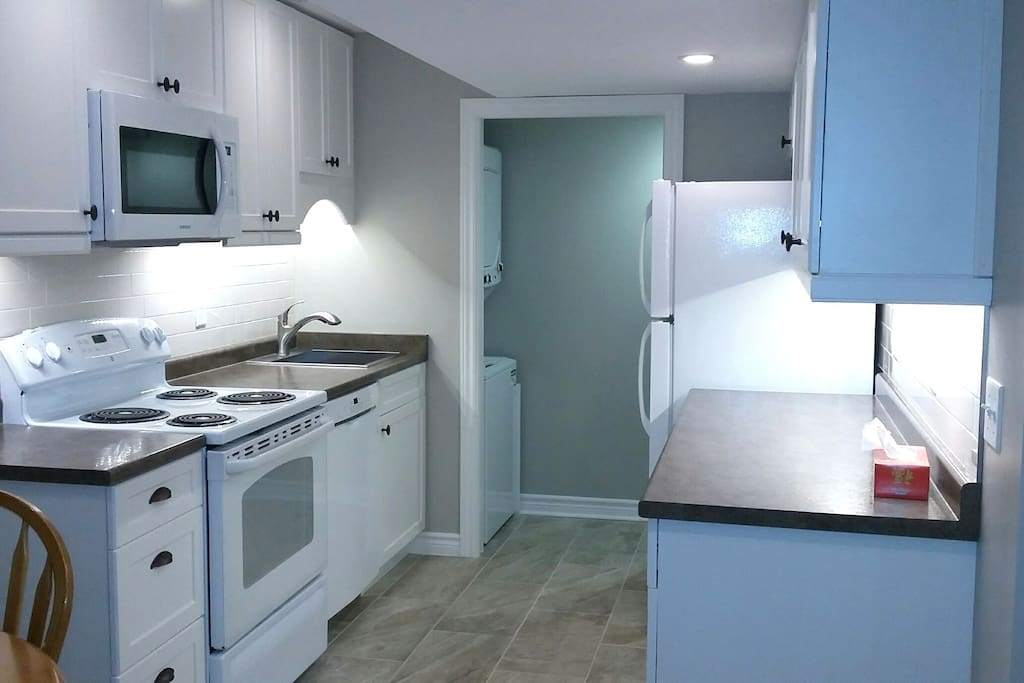Brand new kitchen with on-site washer and dryer