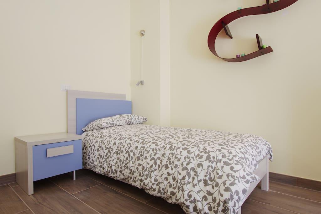 camera tripla particolare letto singolo