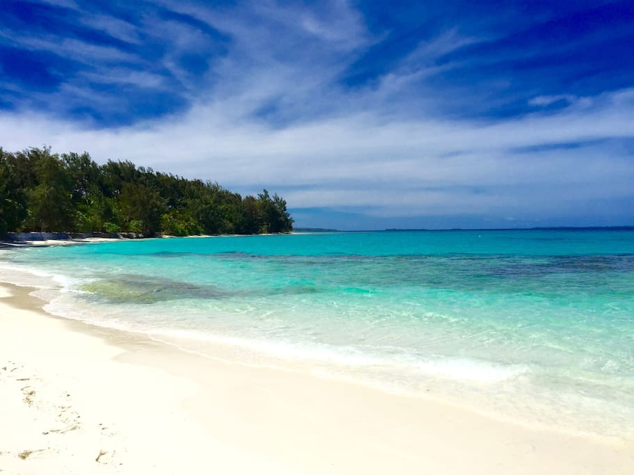 Turquoise lagoon waters fringed by abundant coral reefs