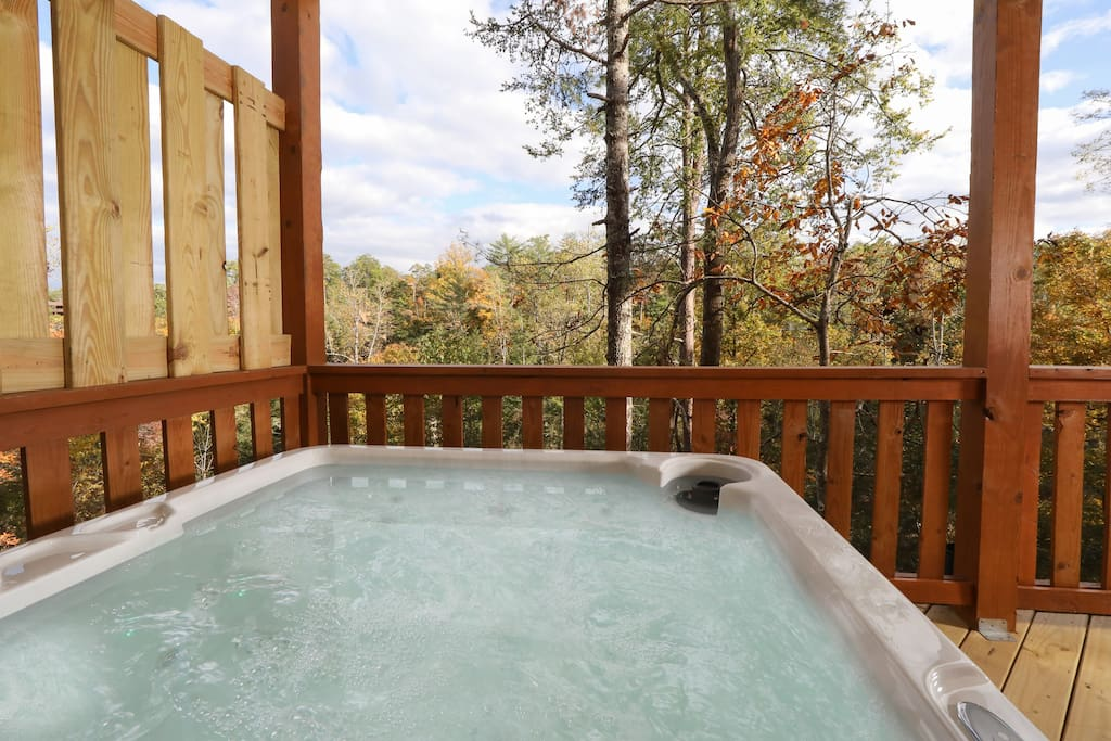 Soothe your cares away in this private hot tub on the lower deck.