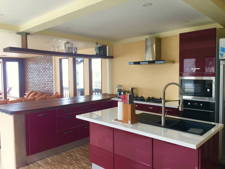 Modern Kitchen fully equipped with microwave, electronic grill, 3 burner hobs.