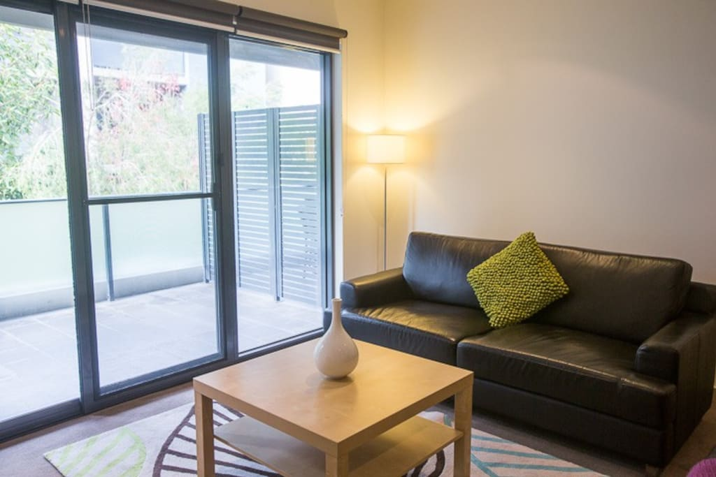 Comfortable lounge-suite, flat-screen TV (with Complimentary Foxtel), and DVD Player