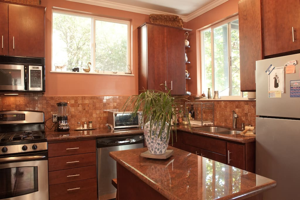 Kitchen w/ Granite Tops and Stainless Steel Appliance