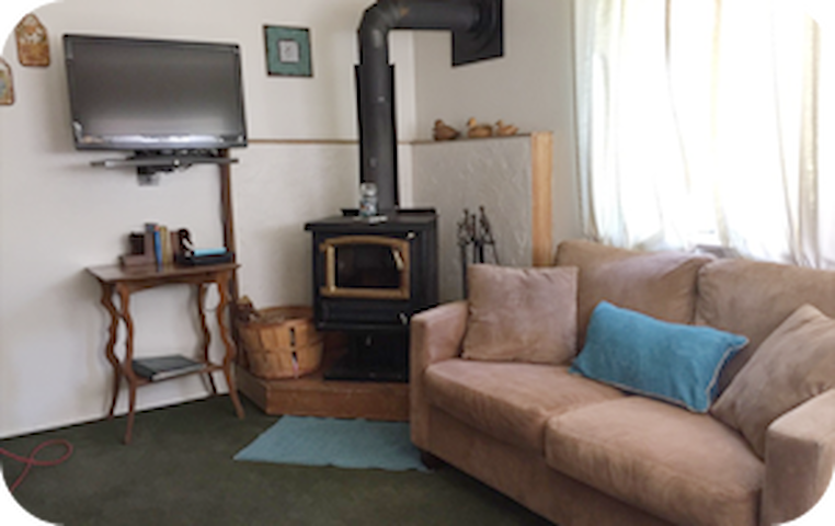 Keep cozy on winter nights old school style with the wood burning stove.