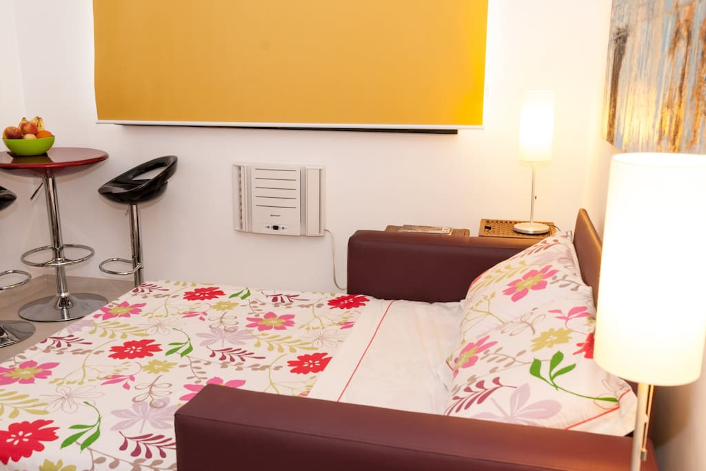 The studio becomes a cosy bedroom with full-size, completely flat mattress, and black-out blind.