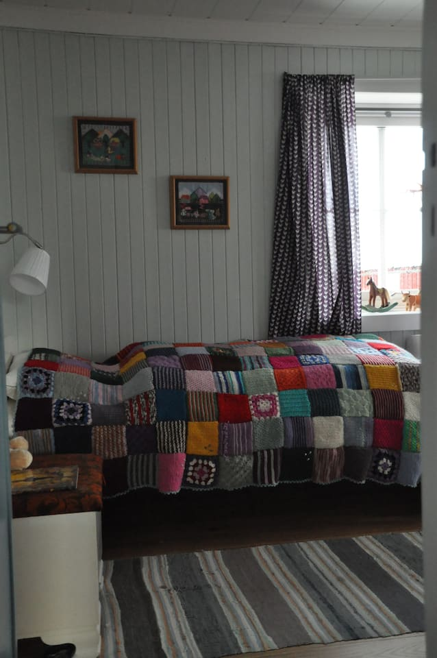 One of the beds in the bedroom utstairs.