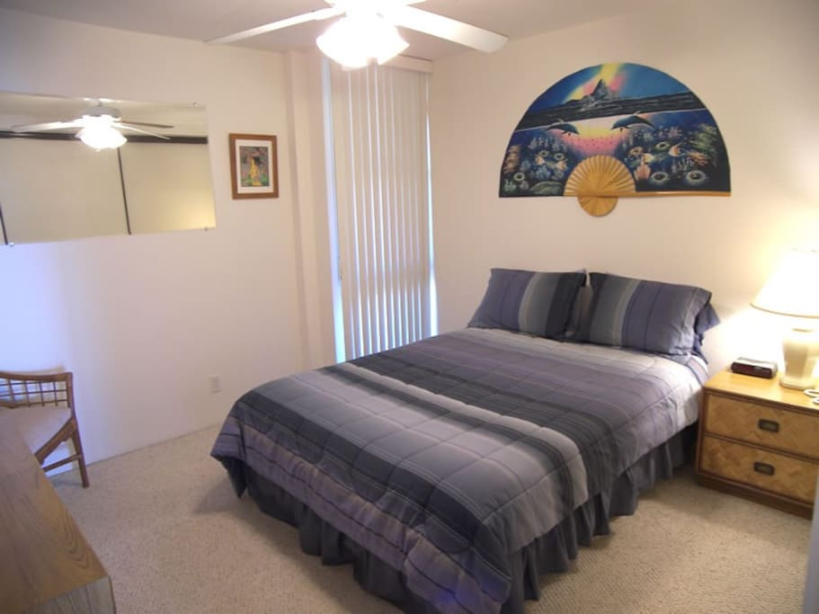Private master bedroom equipped with a queen size bed and a large double closet