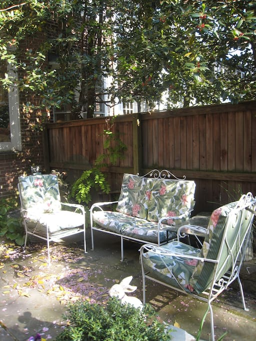 Sitting area under the flowering shade trees on the patio.  Very pleasant quiet space in the heart of Georgetown