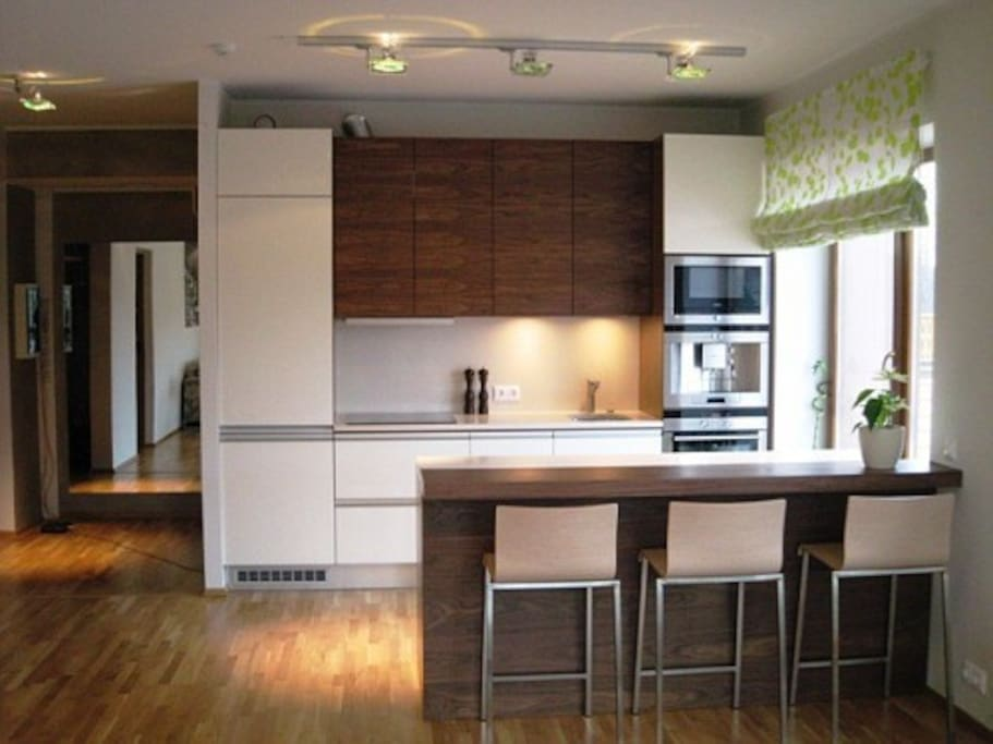 The kitchen with an espresso machine and access to the roof garden (on the right) to enjoy your morning coffee.