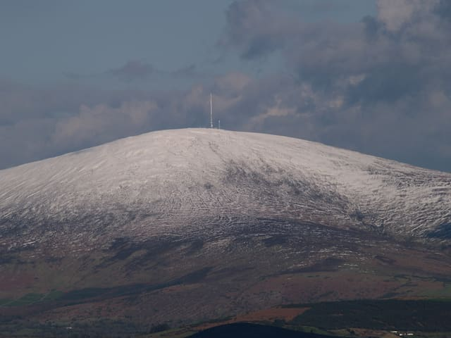 Summit of Mount Leinster 2610 feet with a scattering of snow
