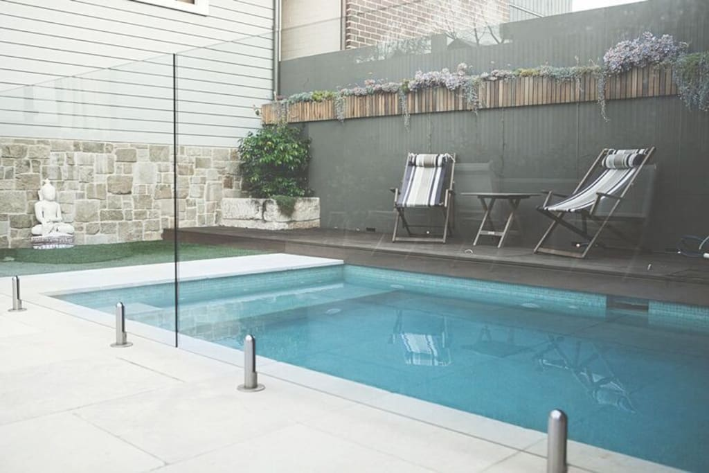 Sunny entertaining courtyard and a heated salt water pool