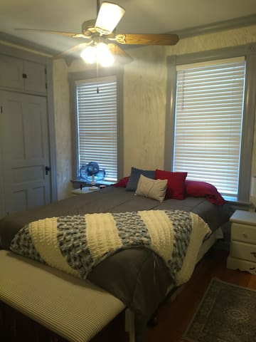 First Guest Bedroom with queen bed.